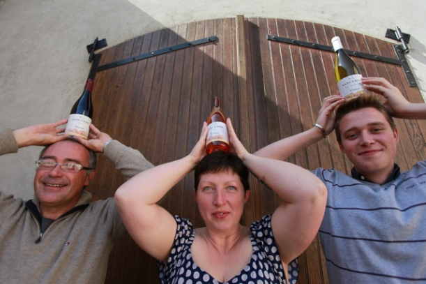 Heads up! Pascal, Nathalie and Rémy Joulin celebrate the 2014 vintage.