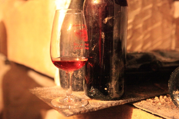 A glass of the 1865 beside its bottle