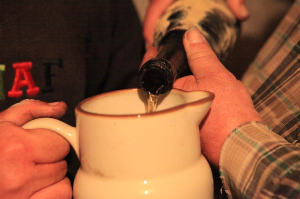 Pouring the 1857 Vouvray into a jug