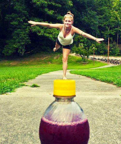 girl-standing-on-bottle-photography-illusion